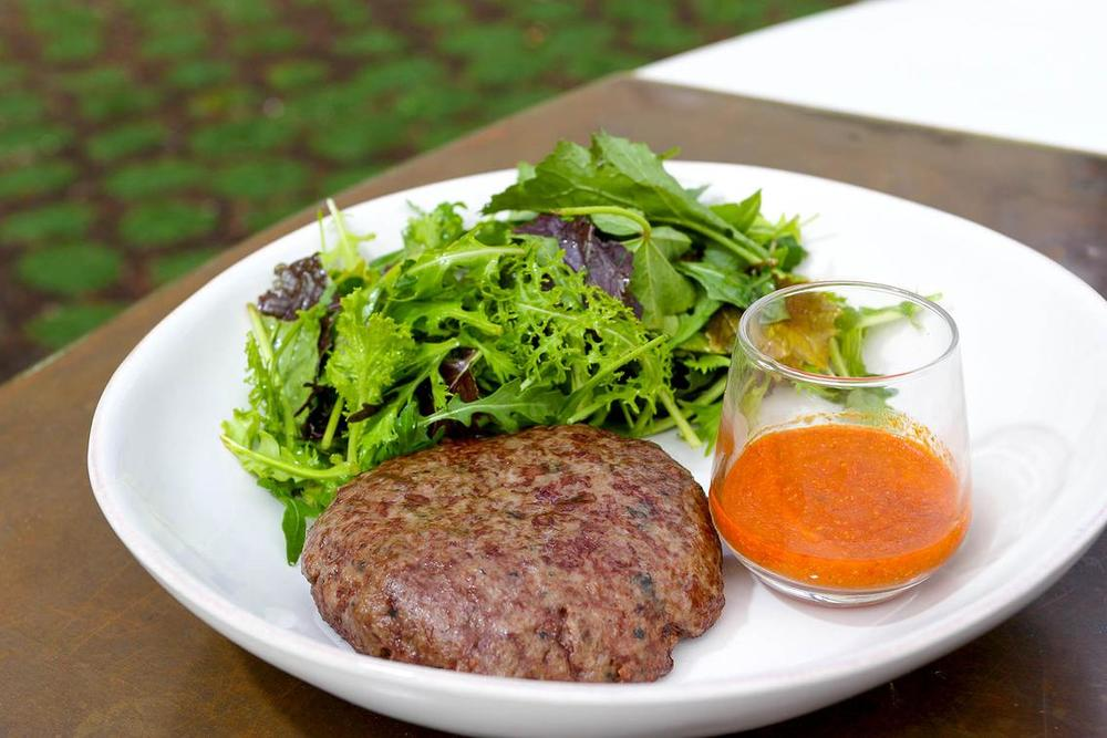 BEEF BURGER SALAD    1/2 pound burger patty of 100% pasture fed beef, with a side of market greens and daily dressing