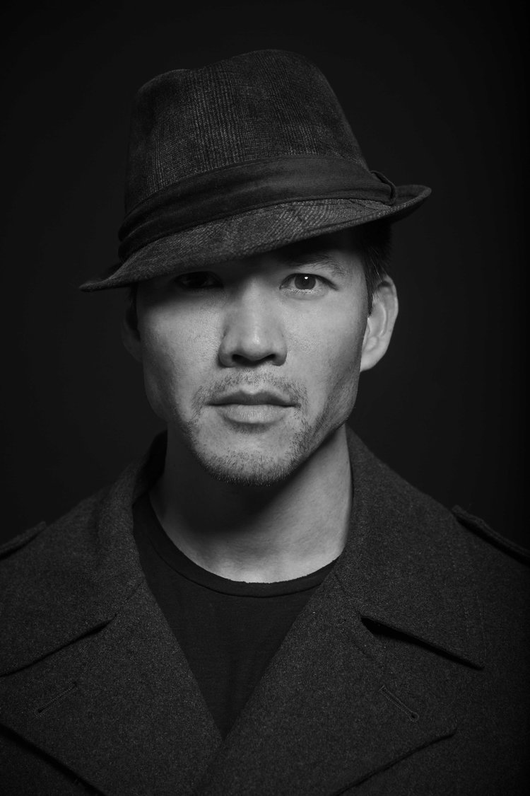 08_Jon-Peacoat-Hat-Black-Background_0358_SM.jpg