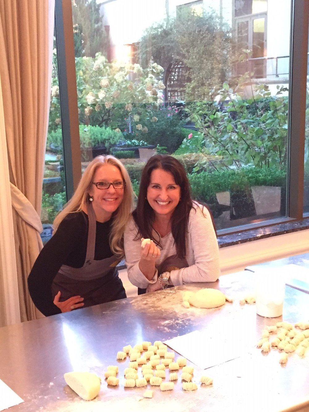 Cindy and Marcia work with culinary teams to make potato gnocchi. Marcia beat the pants off Cindy in the competition! Looks like some delicious team building!
