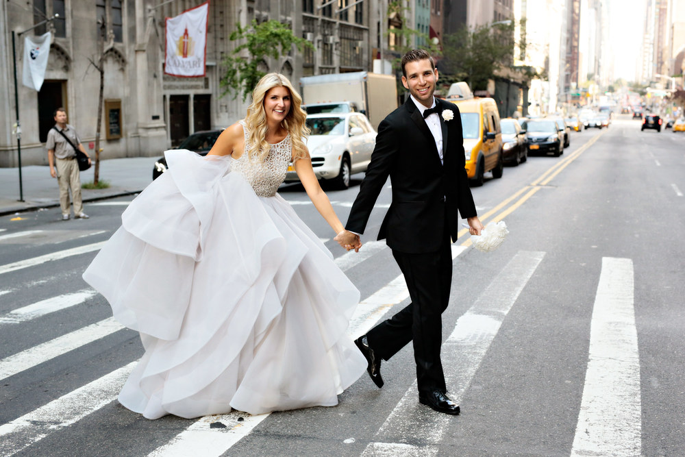 Anna & Josh cross the street in front of the Park Hyatt, NYC