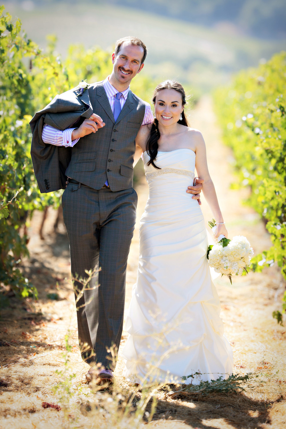 Brian & Perla stop at a vineyard for some portraits before heading to their reception.