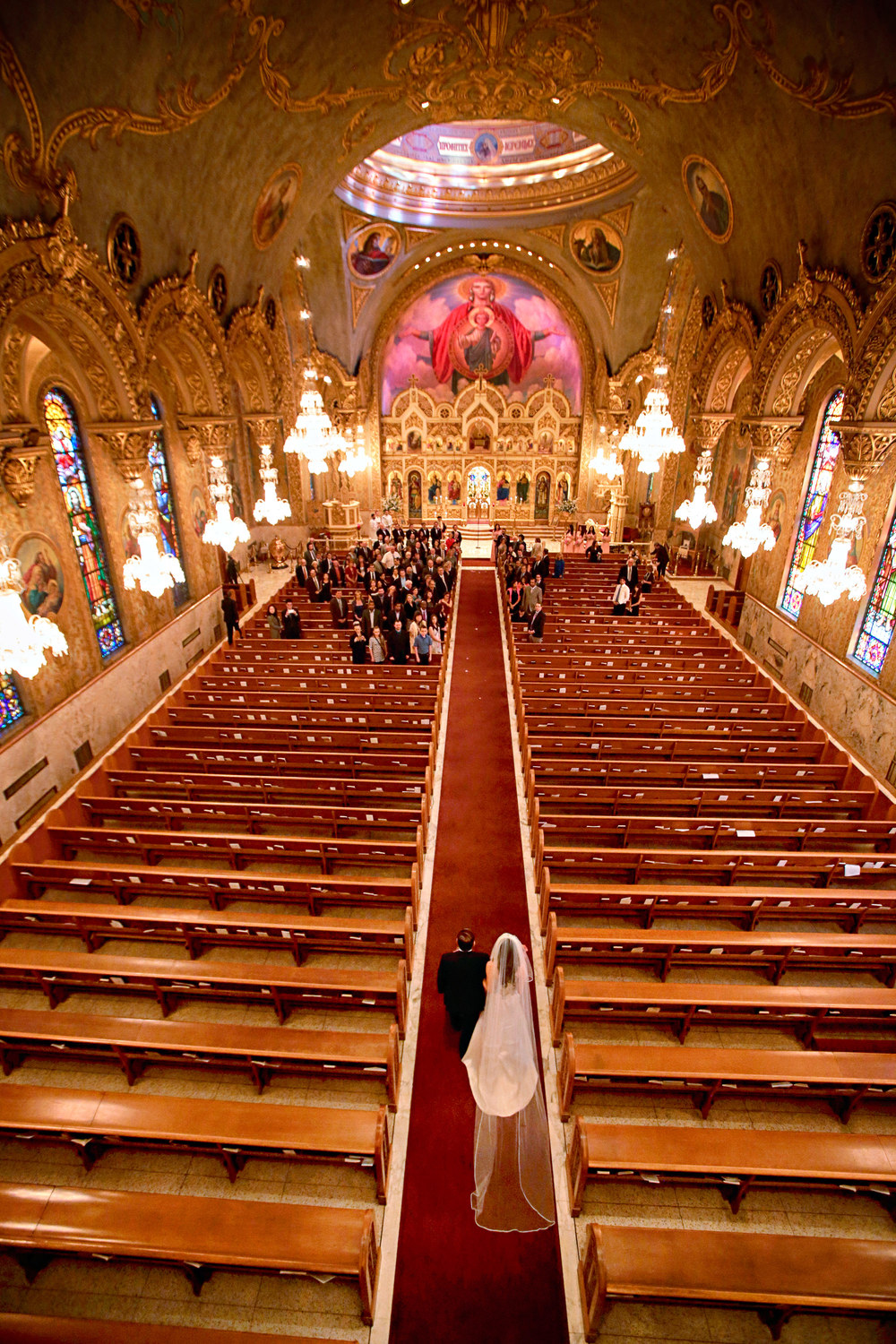 Vivian is escorted down the aisle at St. Sophia's in Downtown Los Angeles.