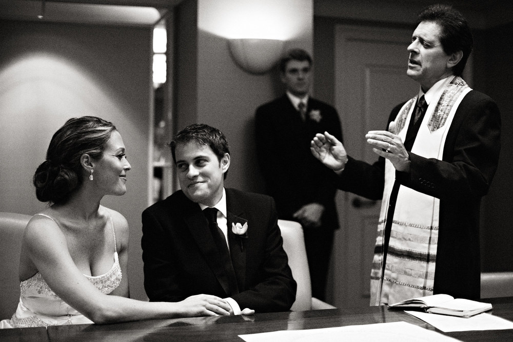 Jessica & Ryan share a glance during the Ketubah signing at the Casa del Mar, Santa Monica