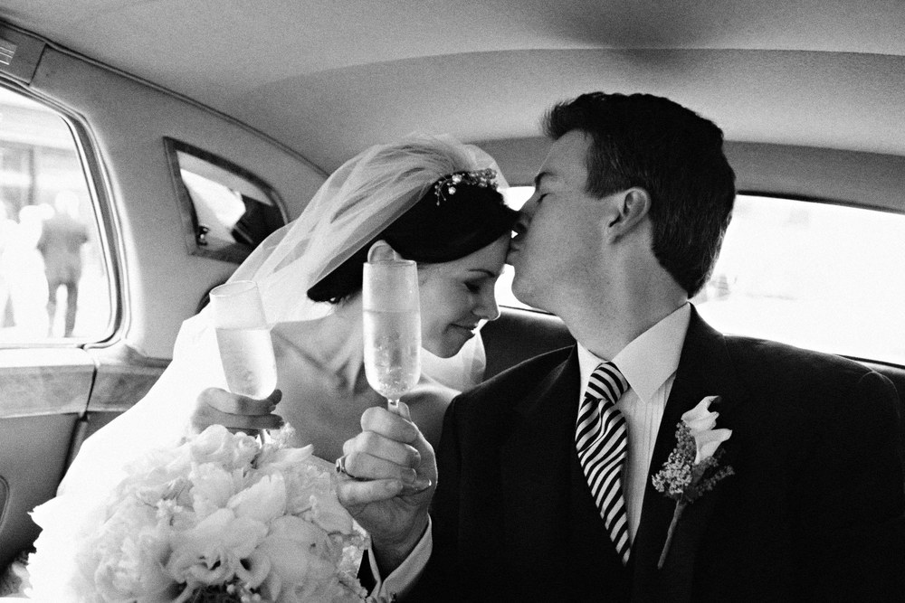Dan & Juliet toast their love on the way to their reception in New Orleans.