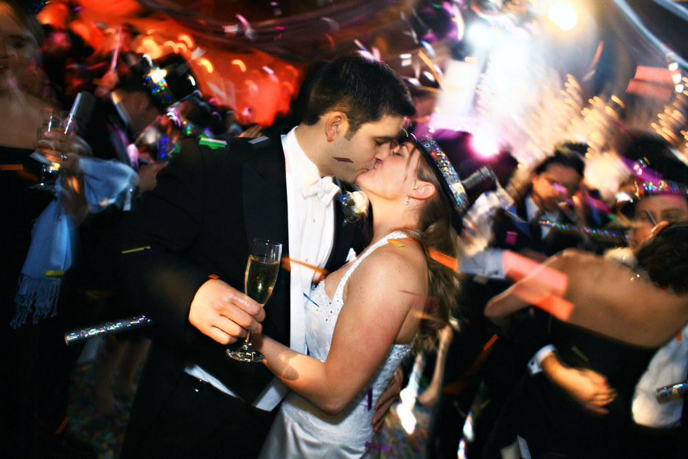 Tara & David ring in the New Year during their reception.