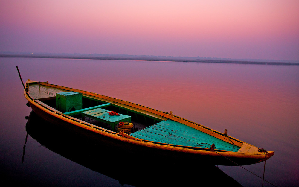 I love to travel and take photos of landscapes and every day life. This image was taken in India along the Ganges river in Varanasi just before sunrise. What a great trip! Thailand is next up on my wish list.