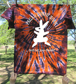 Hand tie-dyed t-shirts with the Pagan Bunny Burn bunny, and the first rule!