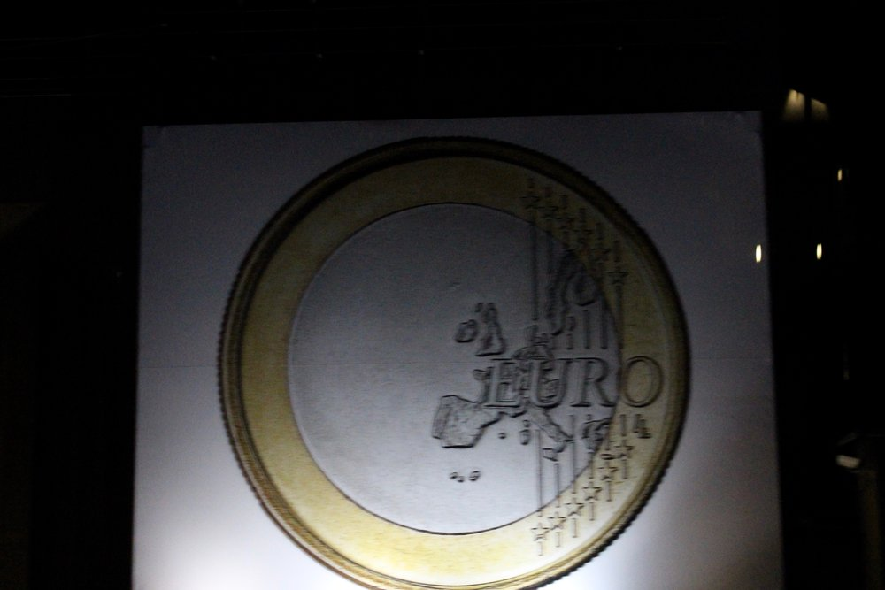 An euro coin on the wall of a giant building we`ve passed...