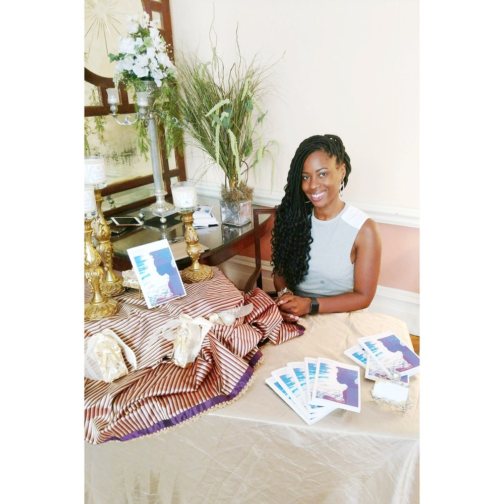 Yesterday at the 5th Quarter Classic Pop-Up Brunch & Art Exhibit signing copies of Swimming In Grace.