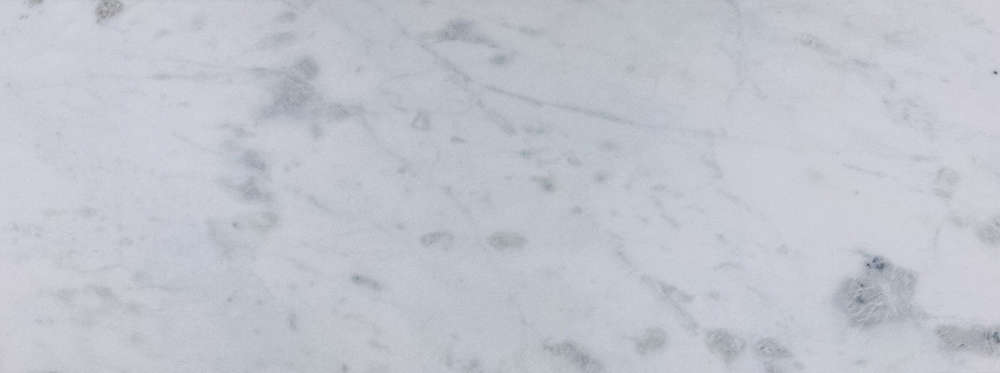 WHITE CARRARA FROM ITALY - MEDIUM-WIDE VARIATION AND SHADE.   THE BEAUTY OF NATURAL STONE IS THAT EACH PIECE IS DIFFERENT AND UNIQUE.  THE PICTURE IS A REPRESENTATION OF THE CHARACTER OF THE STONE'S VEINING AND COLOR ONLY.