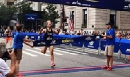 me winning the Fifth Avenue Mile