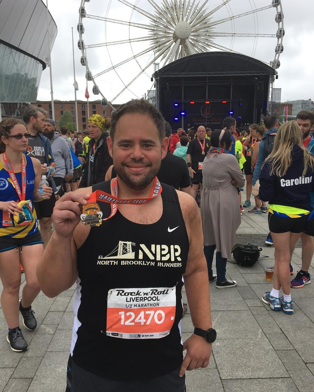 Showing off the medal after the Liverpool Half Marathon