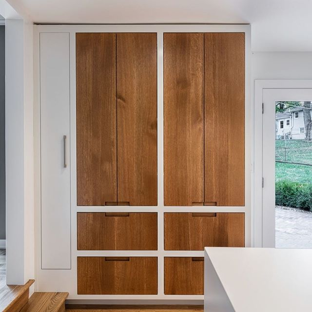 Proud to display this extremely versatile cabinet we did for a @cicada_co kitchen. This slab inset pantry in rift- sawn white oak features vertical grain matching, custom routed pulls, and a broom closet on the side, slightly raised over the steps below. This is some of our best work so far! 📷:@jleggphoto