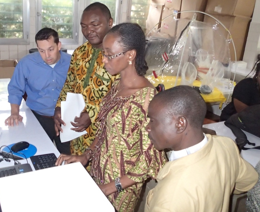 Jeff Takle, Chief Development Officer, helps local NTP staff install GxAlert in French-speaking Guinea