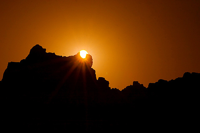 View of the setting sun passing through the notch of the prehistoric Observatory Kokino, Republic of Macedonia