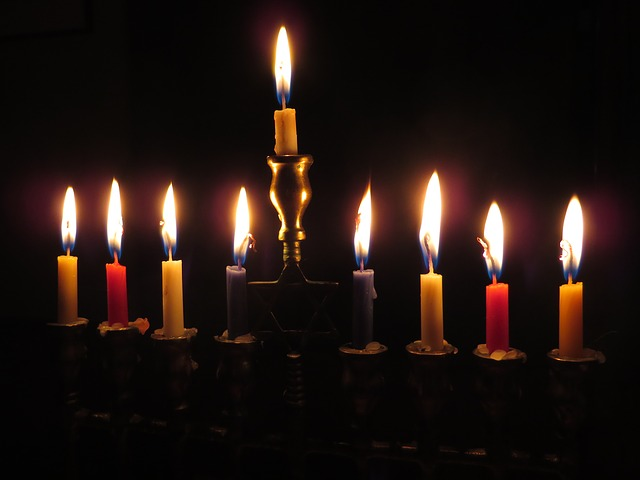 The center candle is the Shamash, the attendant candle. This candle is used to ignite the others, and stands ready to rekindle any that may go out.