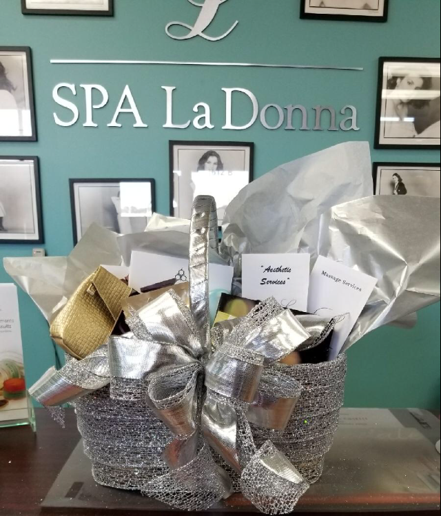 Beautiful and bountiful basket....assortment of products and services from Decatur's own Spa LaDonna.    Donated by: Spa LaDonna