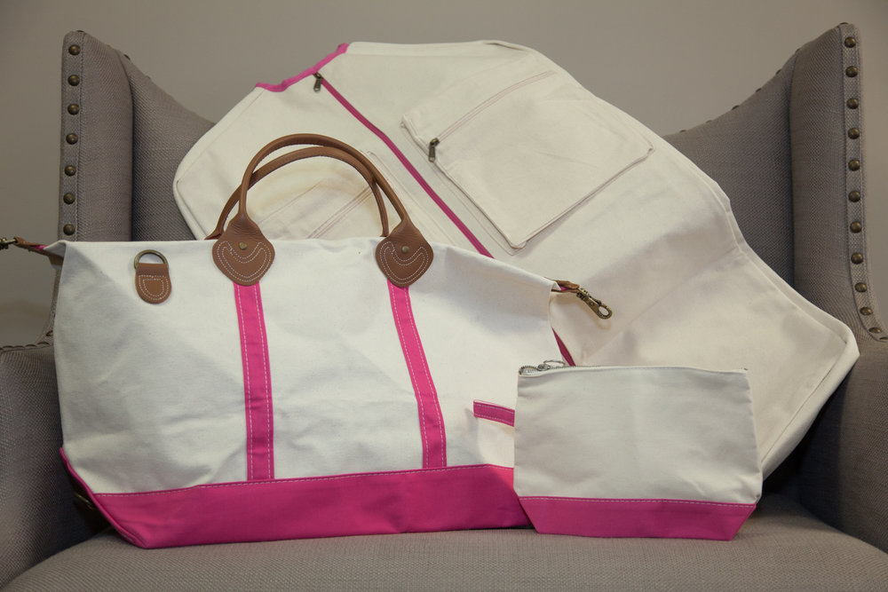 Time to getaway…Ladies weekender bag, garment bag and makeup bag set.    Donated by:  Direct Printing
