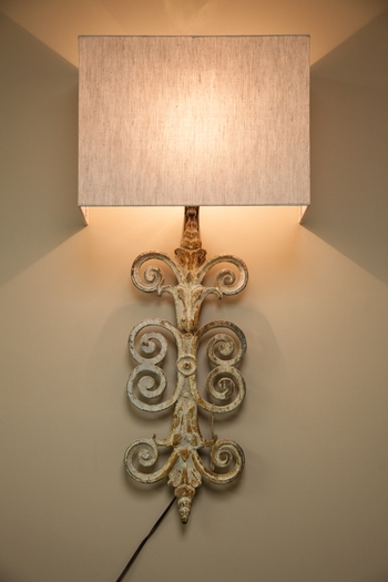 Light it up.... Pair of Cast Iron wall sconces with Linen Shades   Donated by: Old River Antiques and Interiors