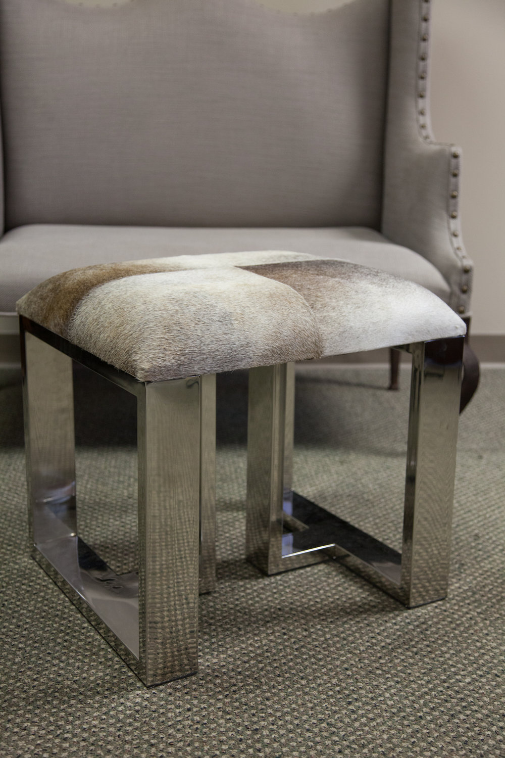 Calf hair stool with shiny mirror finish   Donated by: Friends of DMH Foundatio