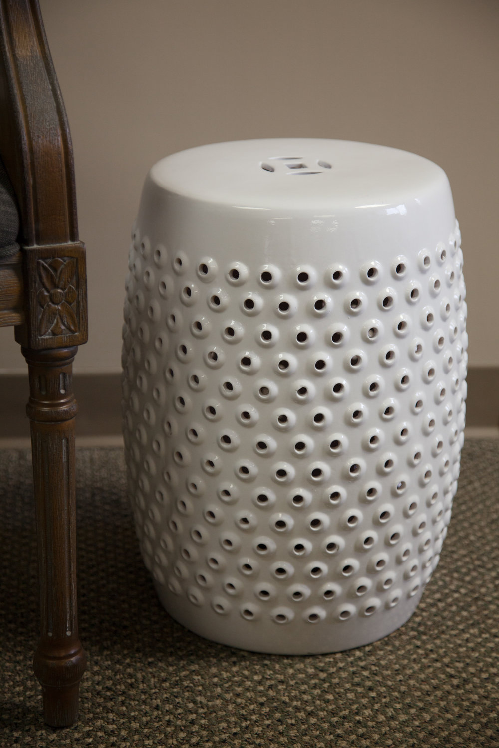 White ceramic garden stool   Donated by: Friends of DMH Foundatio