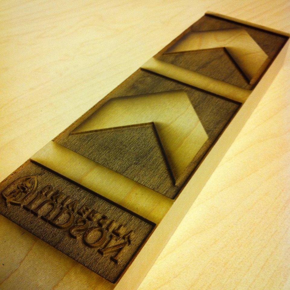 Custom laser-etched wood press/type pieces for the card-making letterpress workshop at Judson University.