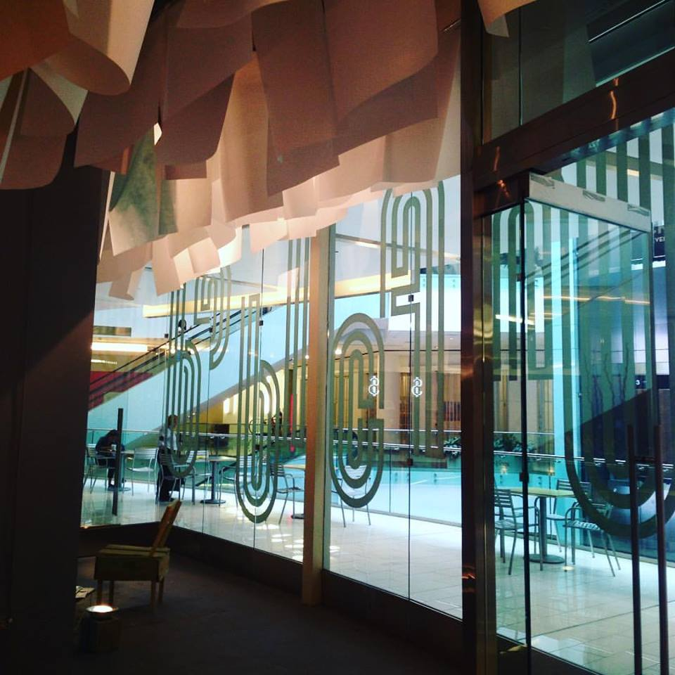 View from the inside of the Chicago Design Museum, located in Block 37 in downtown Chicago. Brand identity design by designer, Nick Adam.