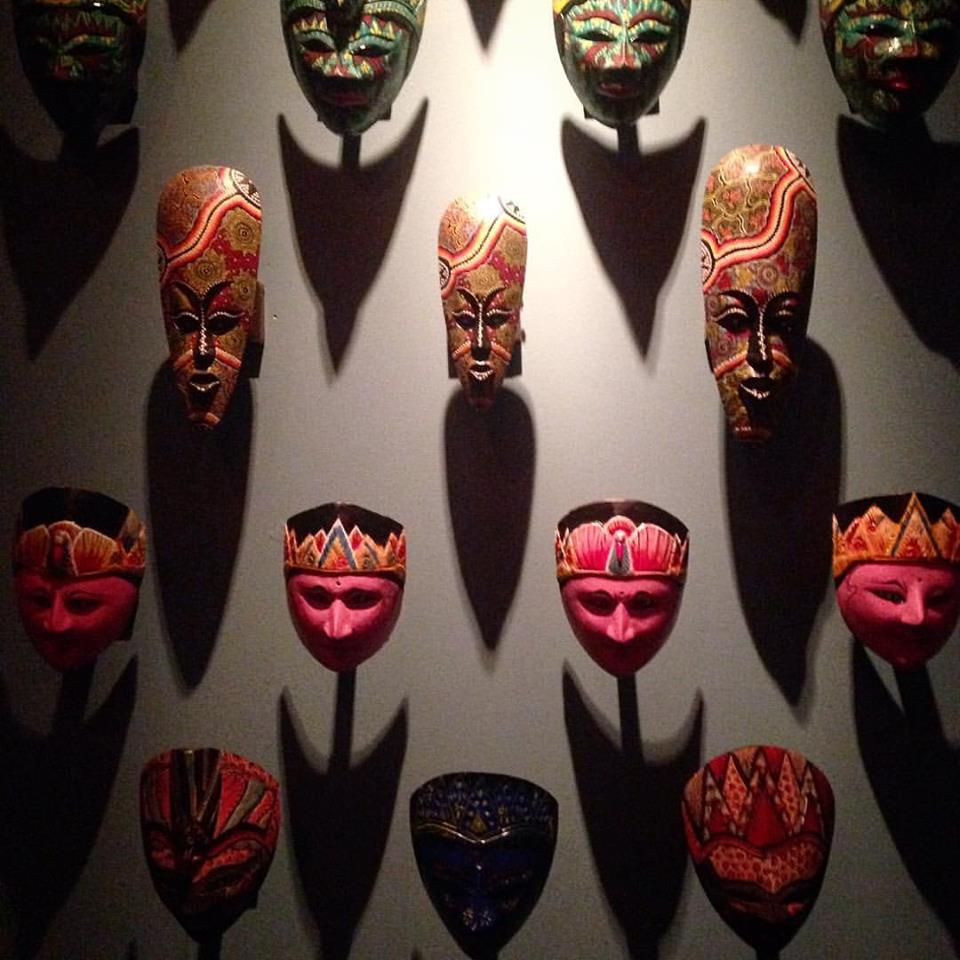 Indonesian masks outside the restrooms.