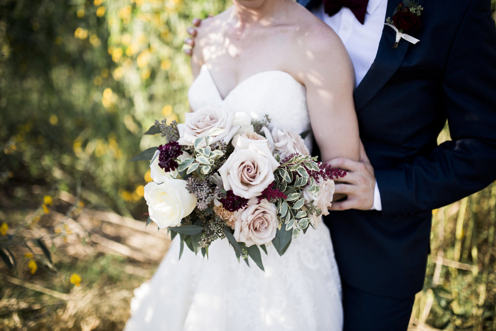 Bride's bouquet: Garden roses, astilbe, scabiosa, spray roses, seeded eucalyptus, and foraged greenery