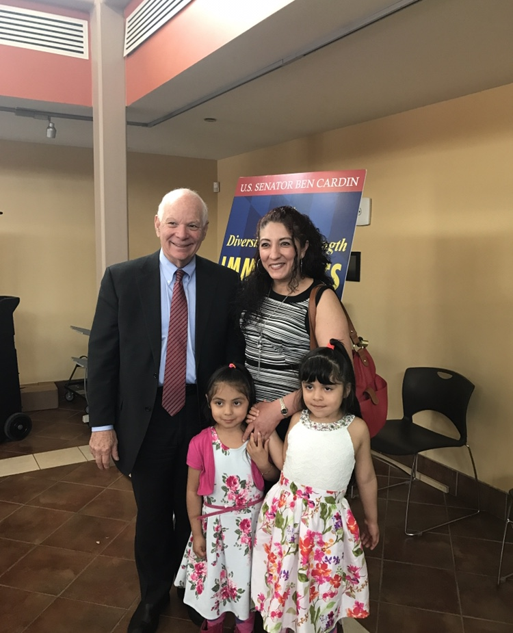 Roxana is pictured here with two of her children and US Sen. Ben Cardin of Maryland.