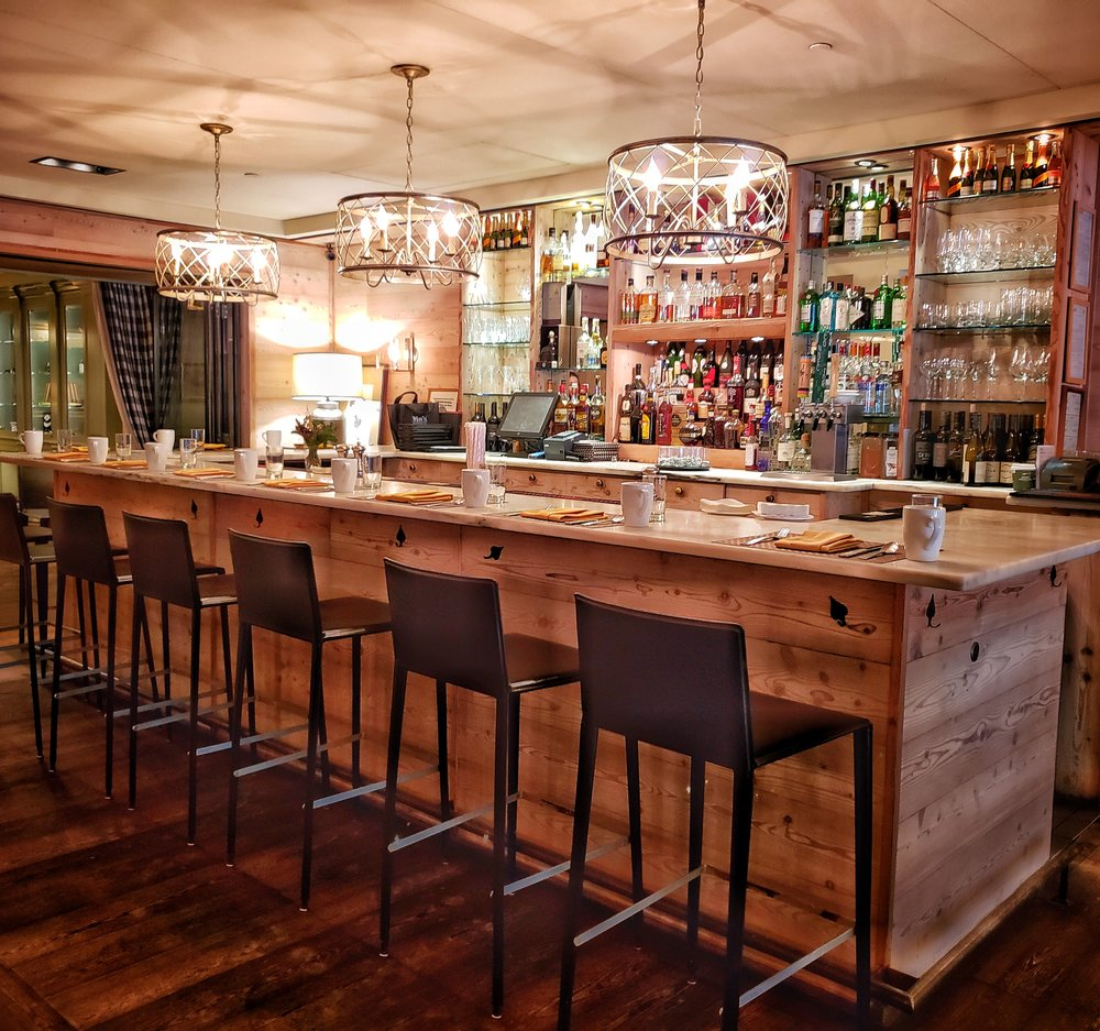 Enjoy a meal or drinks at the beautiful bar at Red Rooster; I'm a fan of the Smoky Vermont Martini!