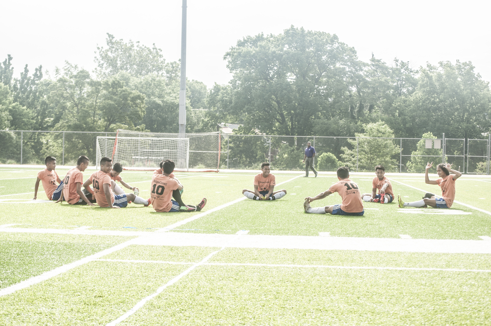 The Myanmar team stretched out before the game started.