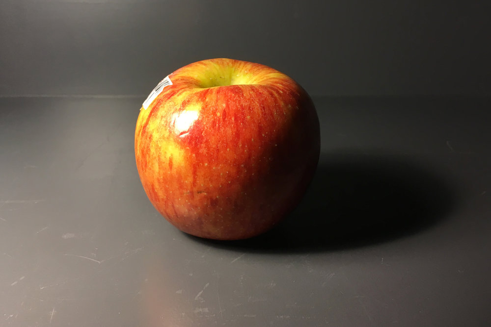 In this picture of an apple, what is instantly observable? We have a three-quarters lighting scenario…. We have a nice cast shadow, and an extremely bright specular highlight. You might be able to point out the core shadow, attached shadow accent, yadayadayada. But  what  and  where  is the shadow pattern?
