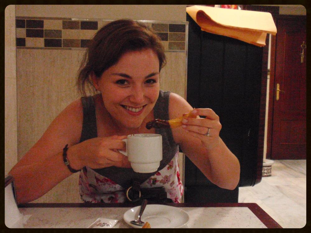 Enjoying churros con chocolate in Seville.