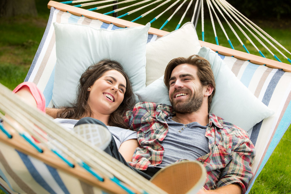 Couple lying in hammock