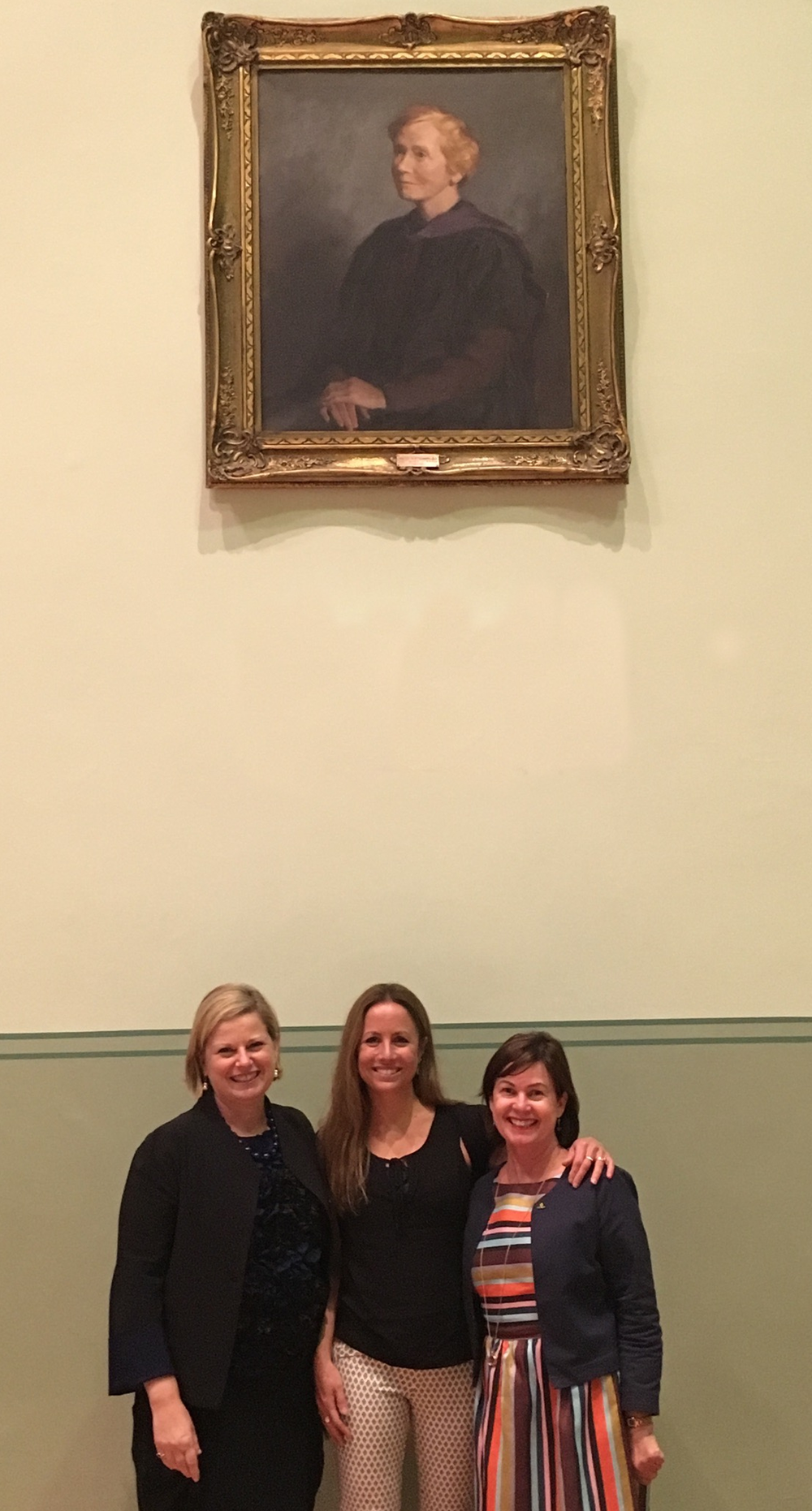 Mac.Rob Foundation Chair Debra Knight, Dr Clare Wright and Principal Dr Toni Meath with the portrait of Christina Montgomery in The Mac.Robertson Girls' High School Hall, 13 October 2016.