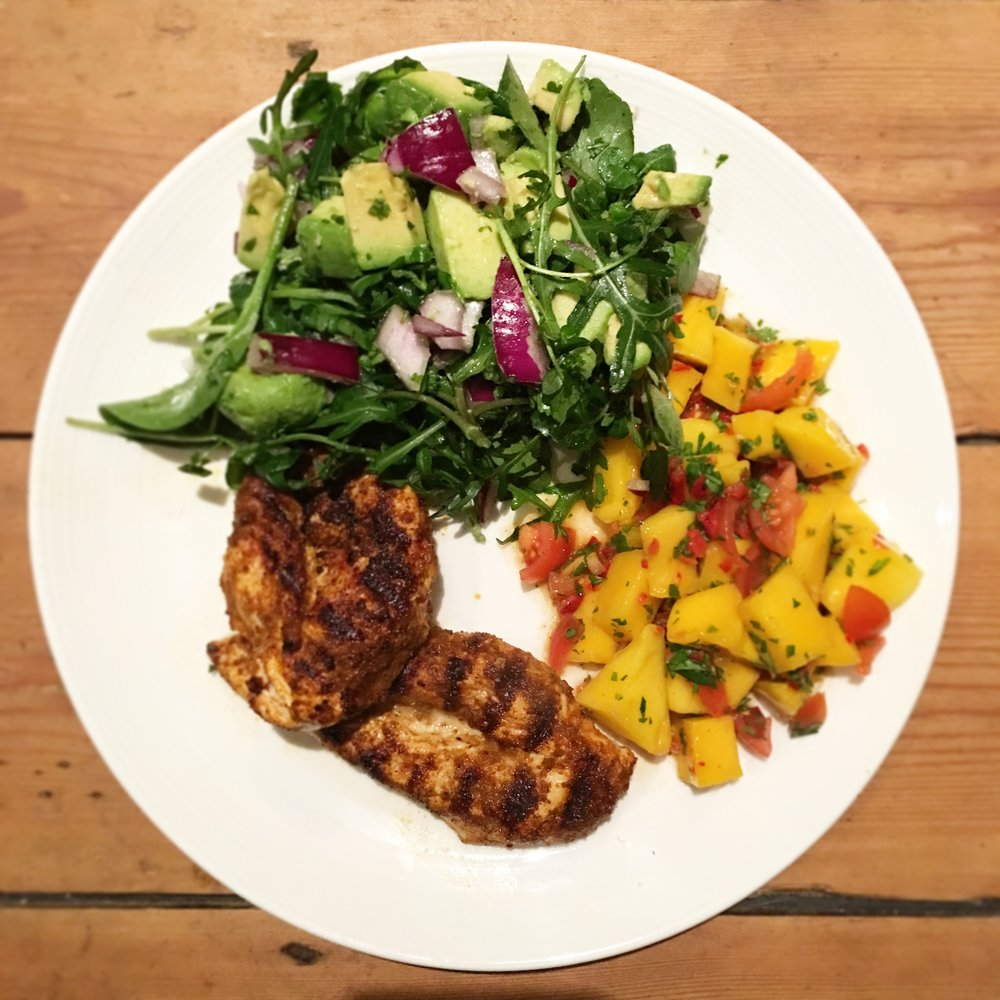 Cajun chicken with avocado salad and mango salsa