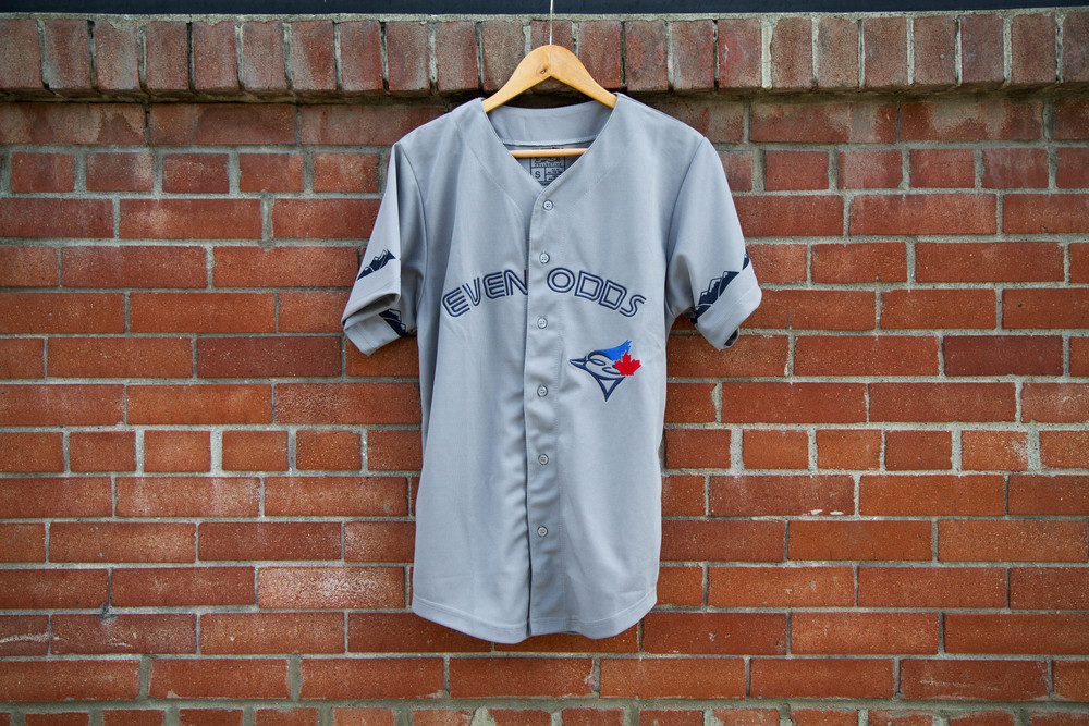 "Authentic jersey fit   Made from 100% polyester. This material is hydrophobic, so it dries out quicker.   Embroidered ""Even Odds"" across the chest   Embroidered EO x Blue Jays logo   Durable screen printing used for mountains on arm and interior screen printed tag."