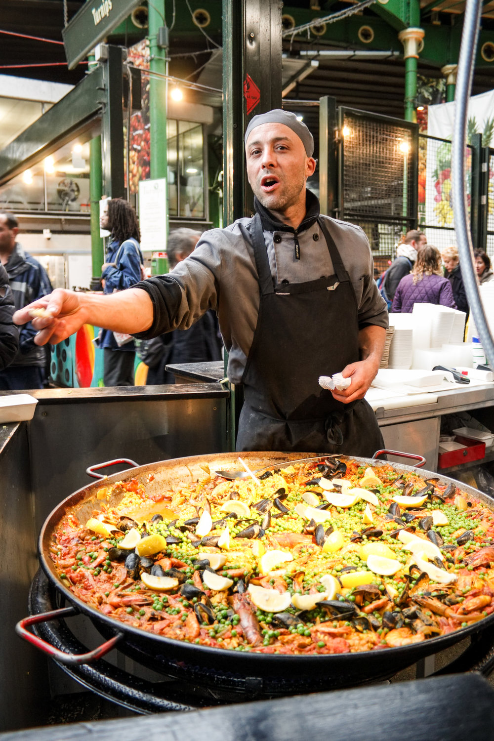 Gigantic pans of paella, filled with fresh seafood at the Borough Market