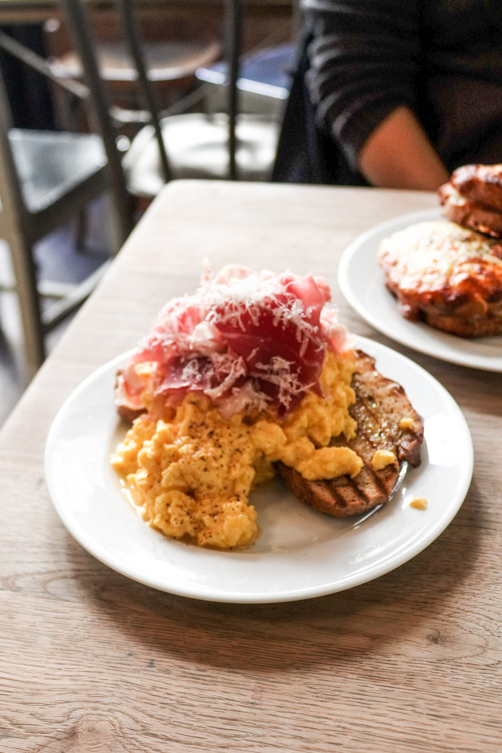 The soft scrambled eggs with proscuitto at Buvette  Below, right: caneles from Patisserie Gilles Marchal