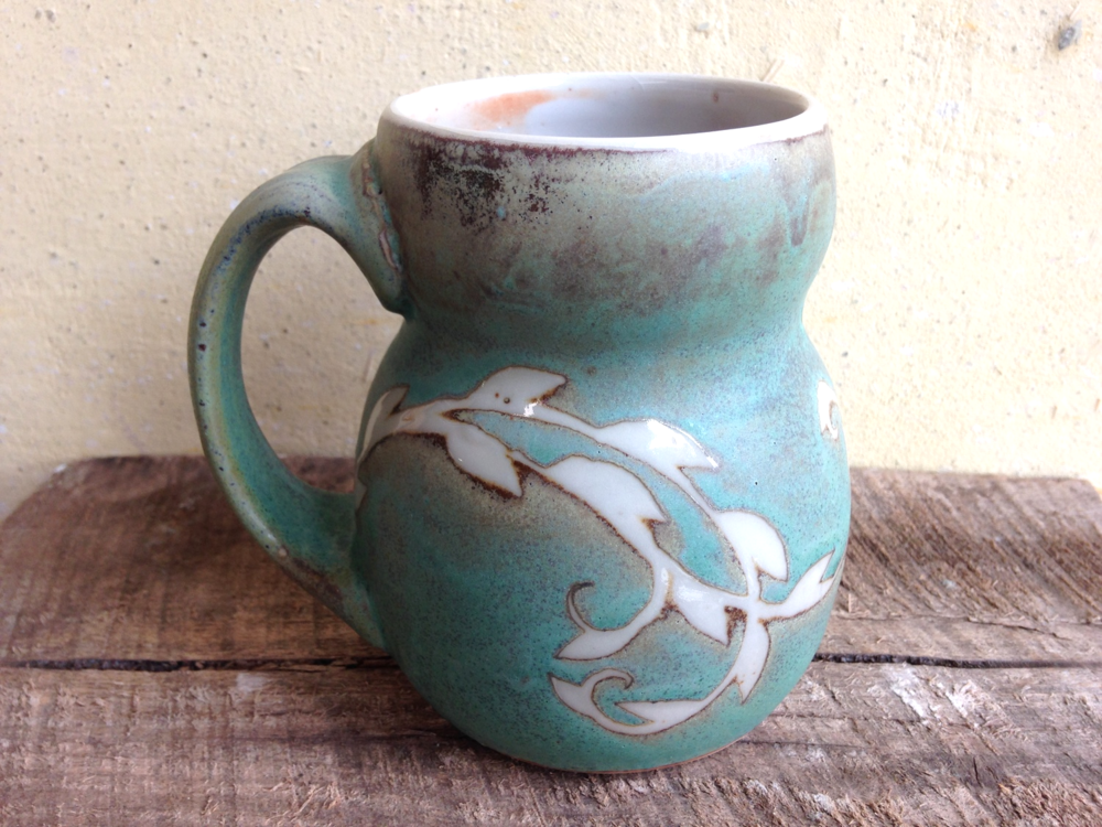 Julie Covington - Marshall, NC.  Patterned turquoise or yellow stoneware.
