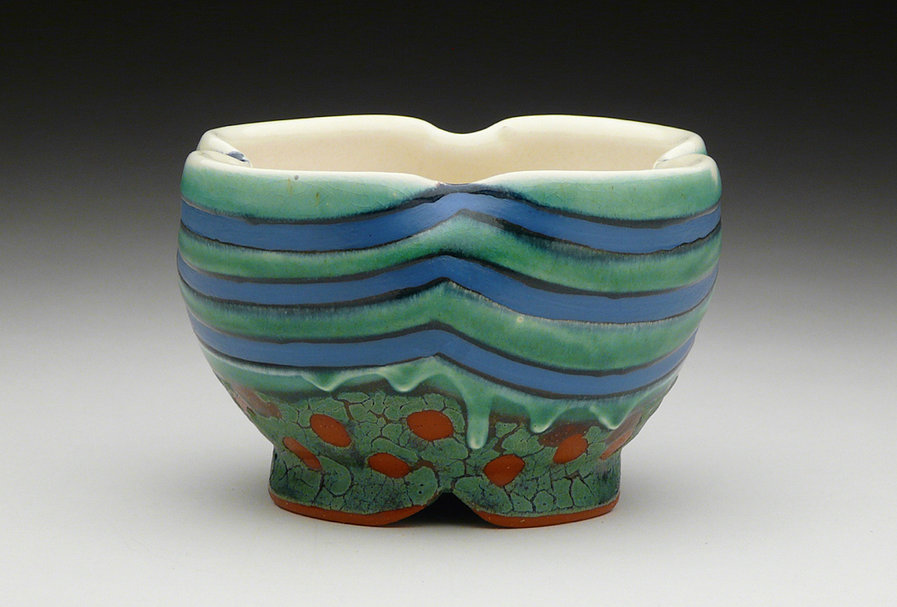 Ronan Peterson - Chapel Hill, NC.  Colorfully decorated thrown bowls, plates, cups, & tea pots.