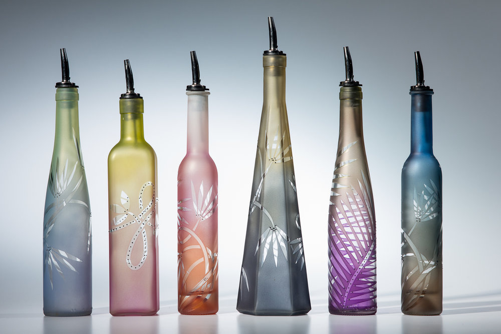Mary Melinda Wellsandt - Seattle, WA.  Functional glass art with sand-blasted designs finished with paint & enamel.