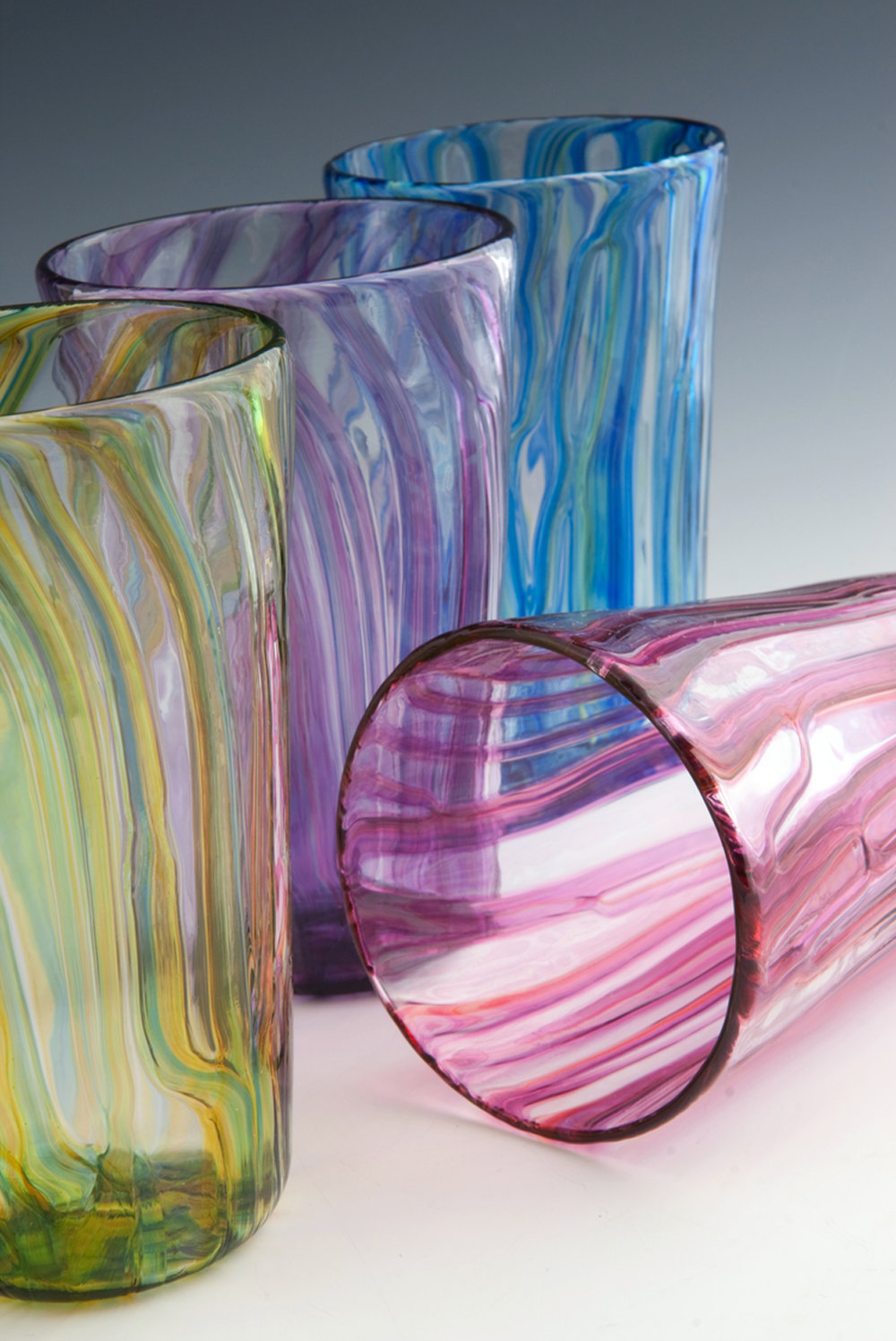 Clancy Designs - Jamestown, RI.  Colorful glasses, pitchers & bowls in a variety of patterns & textures.