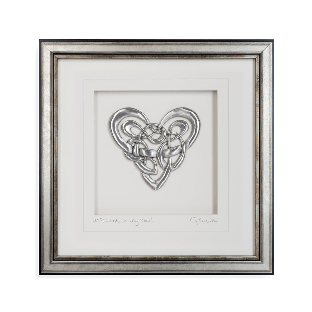 Cynthia Webb - San Diego, CA.  Framed pewter sculptures with inspirational messages for the home.