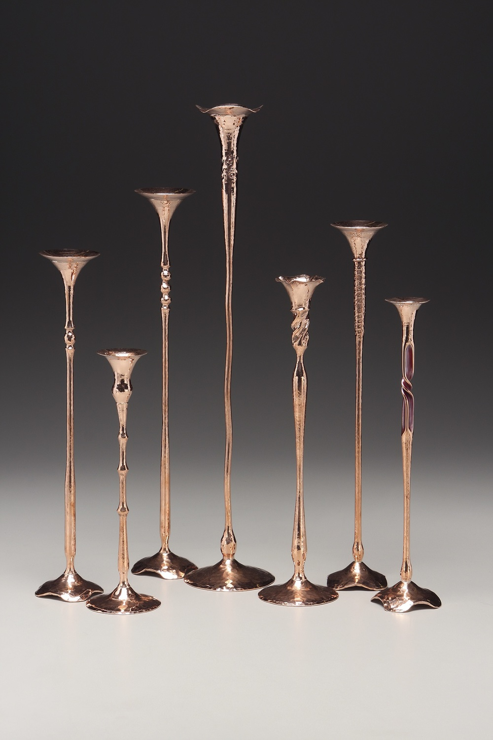 Greg Hessel - San Rafael, CA.  Hand-forged & hammered copper candlesticks.