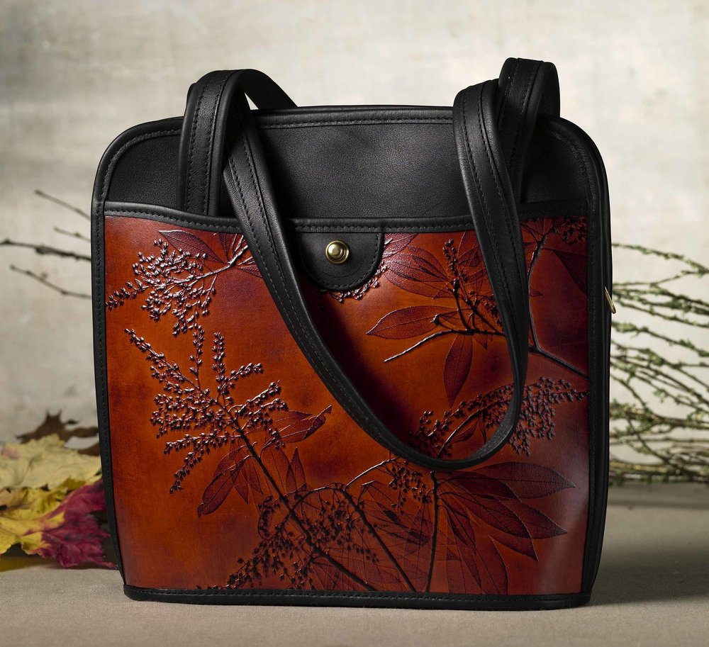 Leaf Leather  Hand-tooled leather bags, wallets, & pouches with detailed leaves & plants.