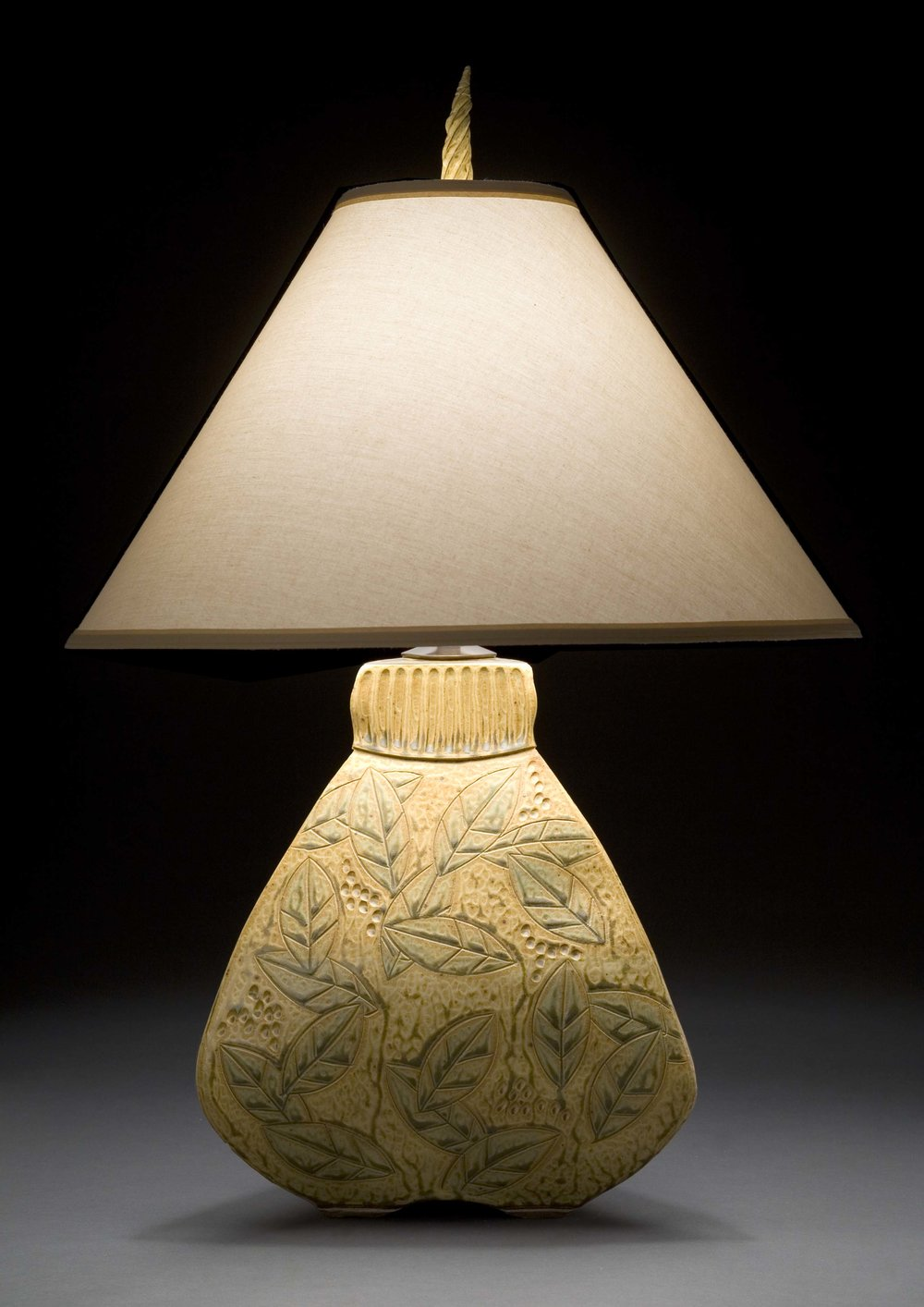 Jim & Shirl Parmentier - Asheville, NC.  Hand-built, carved, & glazed ceramic lamps & functional ware.
