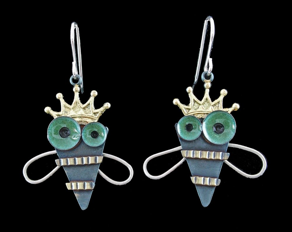 Chickenscratch - Oley, PA.  Whimsical earrings & pins made from a variety of metals & mixed media.