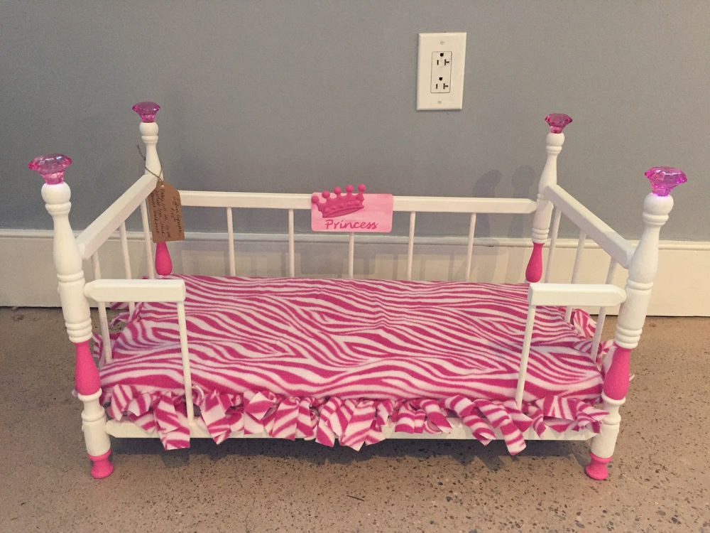 Princess bed  - this was repurposed from an antique doll crib.